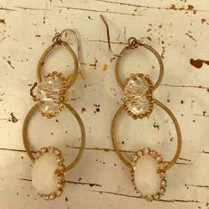 Gold and sting dangling earrings